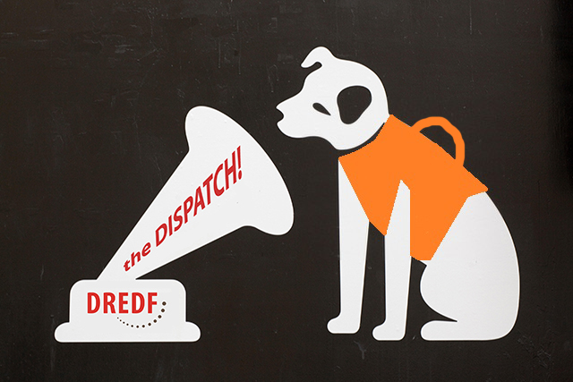 An altered version of the RCA logo. The dog listening to the victrola is wearing a support animal vest. The Dispatch is printed on the Victrola.