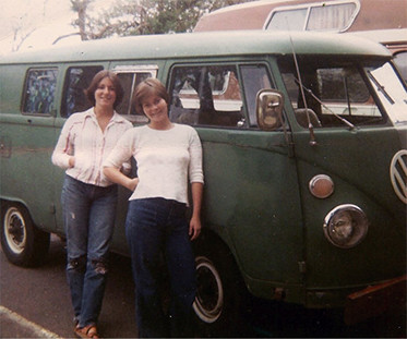 Susan and Andrea pose in front of their VW bus