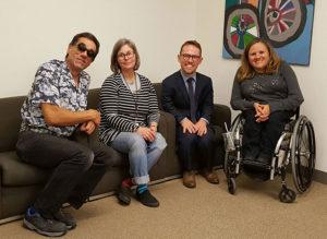 Dmitri Belser, Susan Henderson, Sam Drummond and Christina Mills at the DREDF office