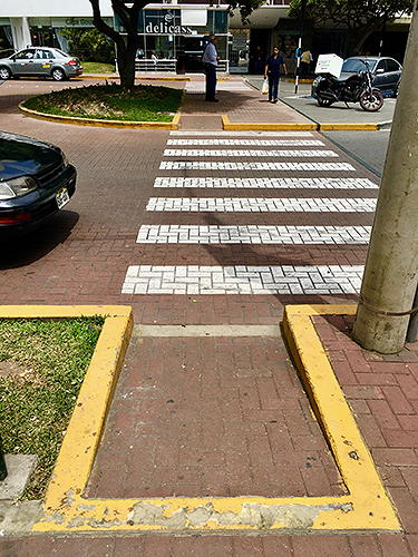 Curb cuts from sidewalk through median strip to other side of street