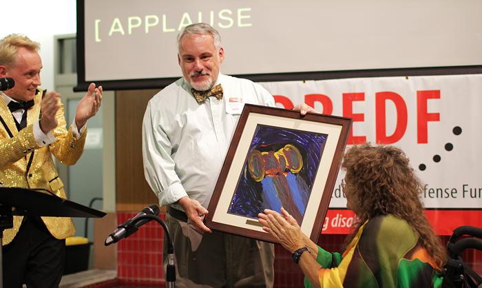 Bruce Darling accepts Rudy Frank Award on ADAPT