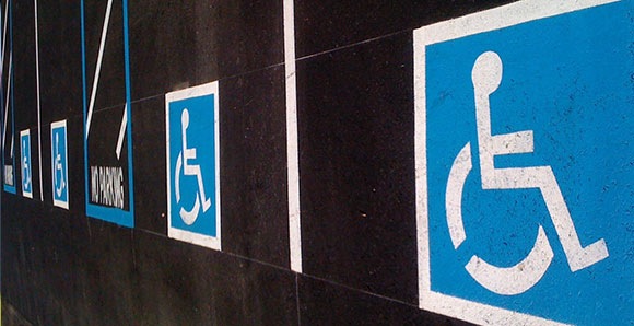 The person in wheelchair symbol on disabled parking spots.