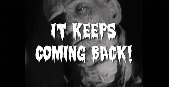Close-up of a Zombie from an old zombie movie. The words: It keeps coming back! over his face