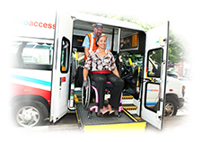 Wheelchair user exiting bus on a ramp