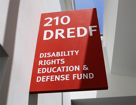 Sign at DREDF's office reads: DREDF Disability Rights Education and Defense Fund