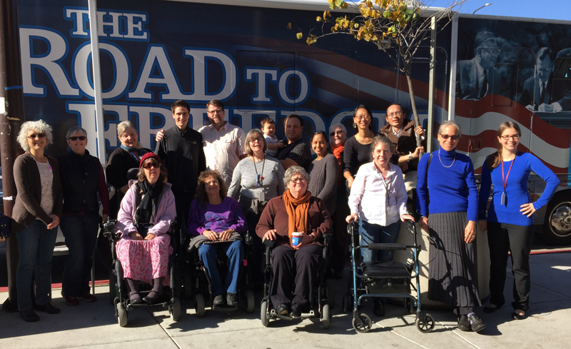 DREDF staff pose in front of The Road to Freedom Bus in Berkeley, California.