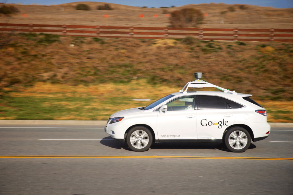 A Google autonomous vehicle in motion on a country road