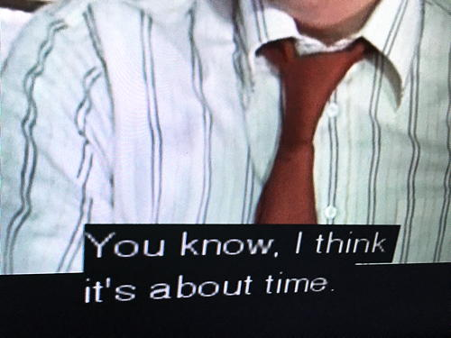 "A cropped screenshot from tv showing a man's shirt and tie. The caption reads: ""You know, I think it's about time."