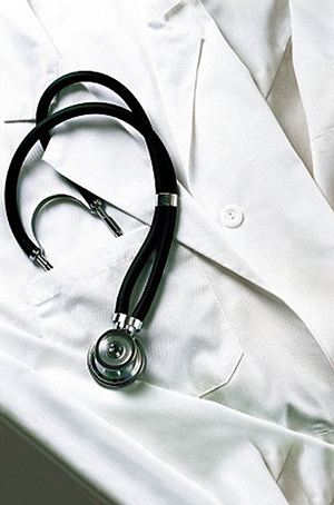 White doctor's coat with stethoscope in pocket