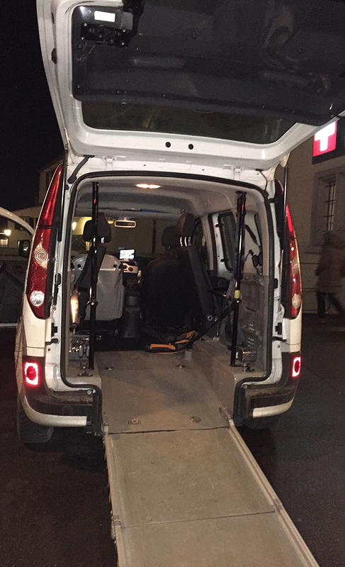 Rear view of a van with the wheelchair ramp extended