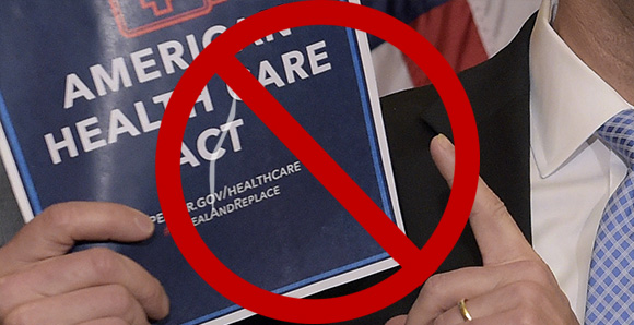 Hands holding a copy of the AHCA bill with a red circle and line superimposed over it.