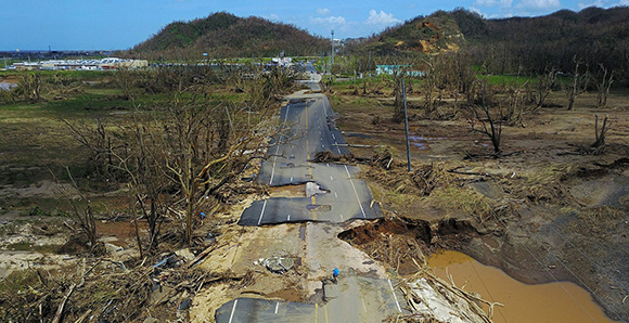 Muddy water and damaged road in Puerto Rico